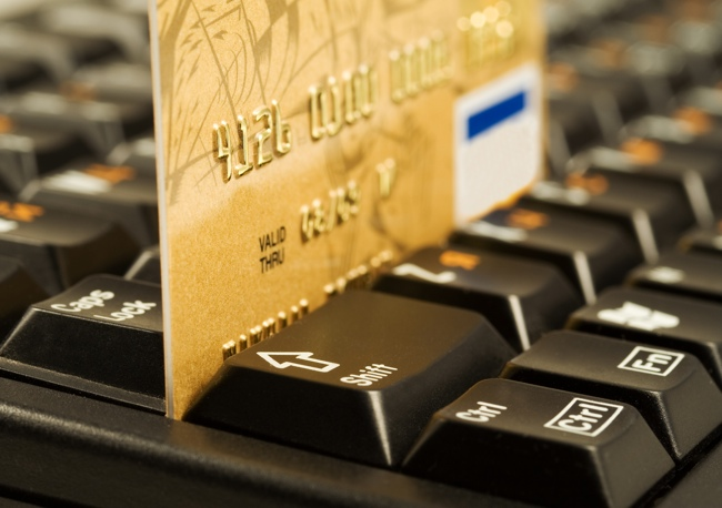 Gold credit card on computer keyboard